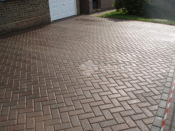 Block paved driveway after 2nd coat sealer applied